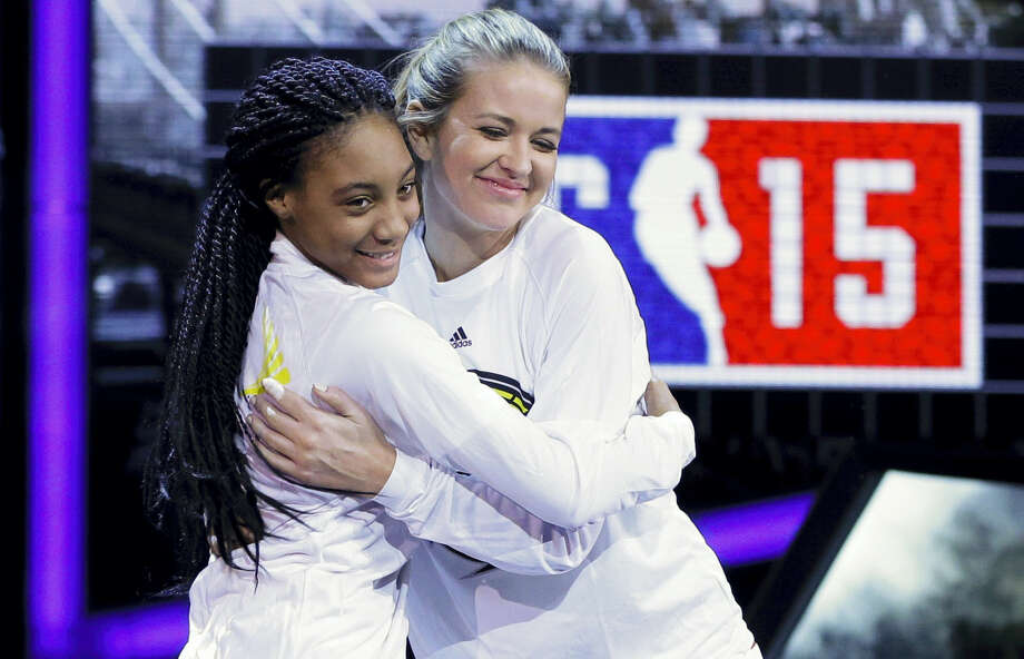 Kristen Ledlow, right, hugs Mo'ne Davis as they are announced before the NBA All-Star celebrity basketball game in New York in 2015. Photo: The Associated Press File Photo  / Copyright 2016 The Associated Press. All rights reserved.