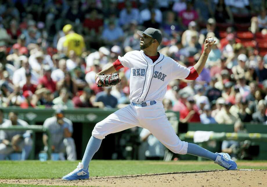 David Price delivers a pitch against the Mariners Sunday in Boston. Photo: Steven Senne — The Associated Press  / AP