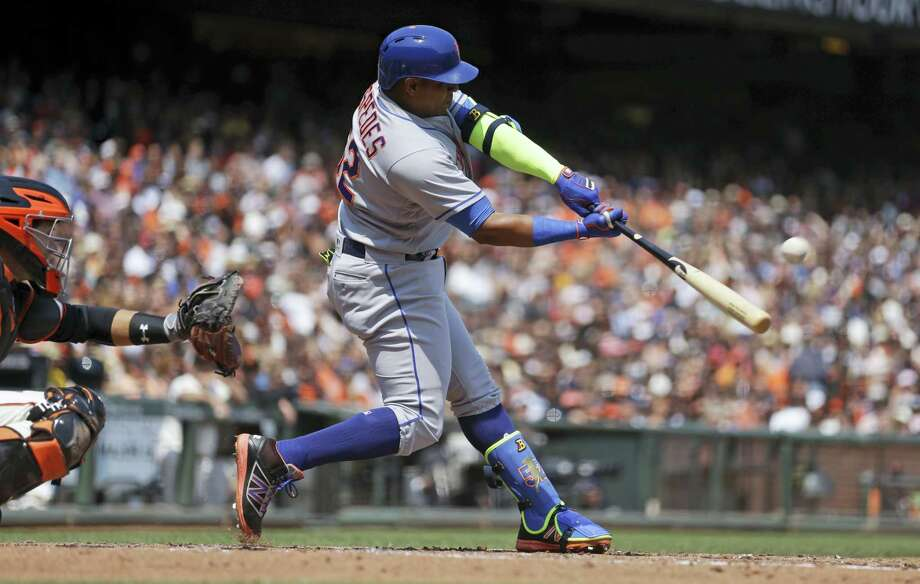 New York Mets' Yoenis Cespedes connects for a home run off San Francisco Giants pitcher Matt Moore in the third inning of a baseball game Saturday in San Francisco. Photo: Ben Margot — The Associated Press  / Copyright 2016 The Associated Press. All rights reserved. This material may not be published, broadcast, rewritten or redistribu