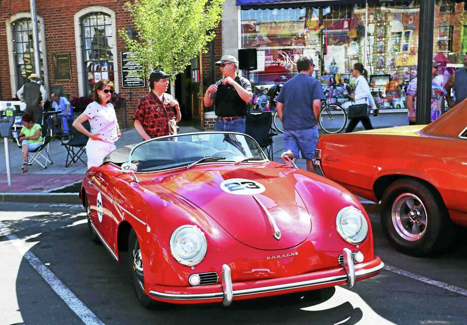 Chairman Gregory Shook of the Middlesex County Chamber of Commerce, right, shows attendees his vintage Porsche race car at the 19th Annual Car Cruise on Main Wednesday in Middletown. Photo: DeKine Photo LLC  / (c)DE KINE PHOTO LLC
