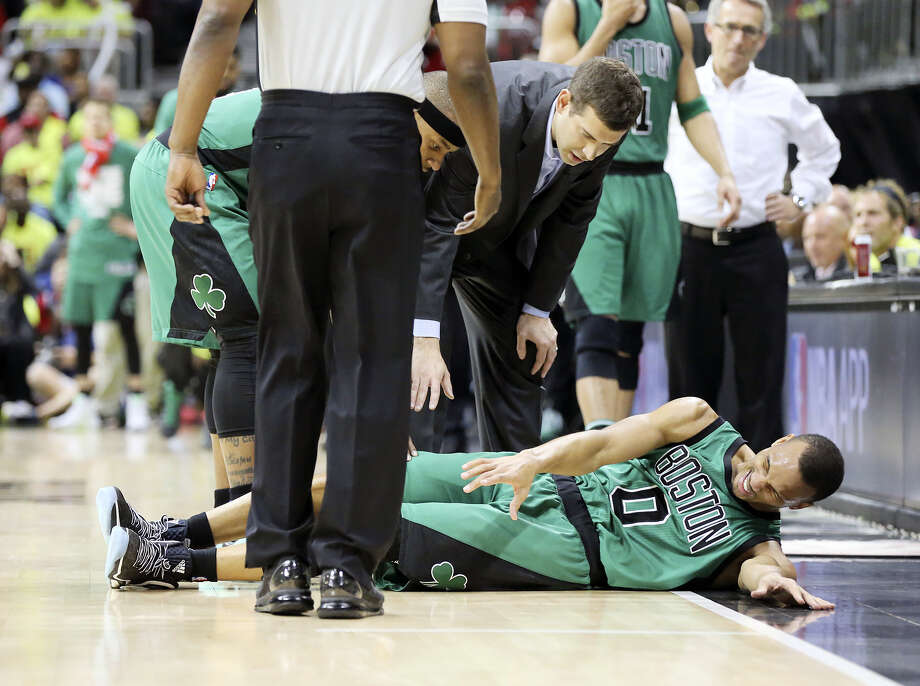 Celtics guard Avery Bradley goes down to the hardwood during Game 1 against the Hawks on Saturday. Bradley is expected to miss the remainder of the series with a hamstring injury. Photo: Curtis Compton — Atlanta Journal-Constitution Via AP  / Atlanta Journal & Constitution