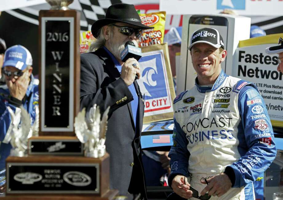 Carl Edwards, right, smiles as he's interviewed by track announcer Tom Taylor after winning in Bristol, Tenn., on Sunday. Photo: Wade Payne — The Associated Press  / FR23601 AP