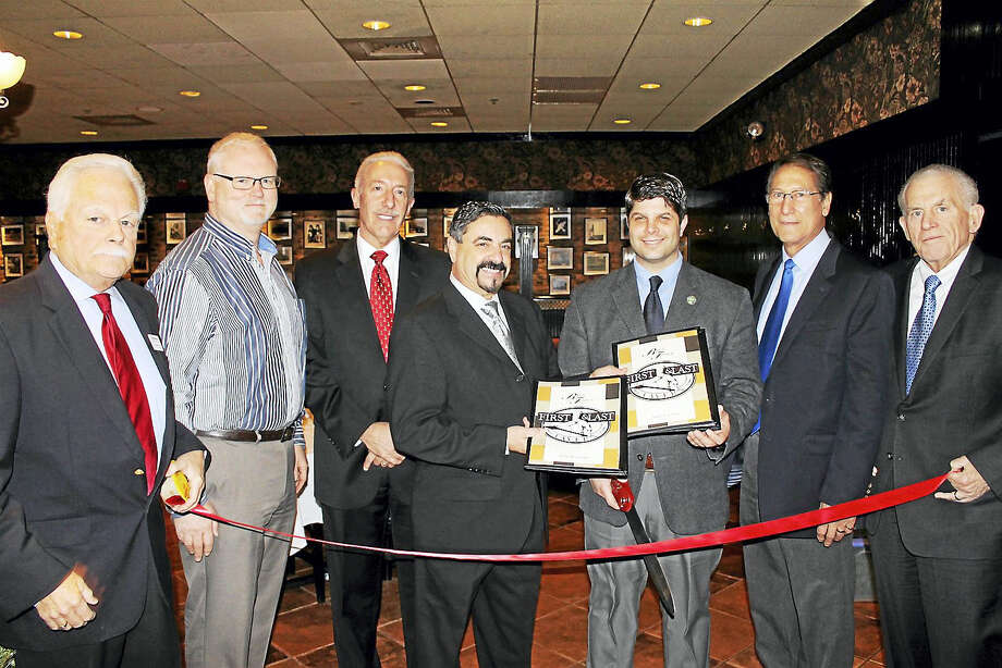 First and Last Tavern held a grand reopening in Middletown Dec. 8. Pictured from left are: Middletown Small Business Development Counselor Paul Dodge, Central Business Bureau Chairman Tom Byrne, Middletown Probate Judge Joseph D. Marino, First and Last Middletown Owner Tony Scacca, Middletown Mayor Dan Drew, Middletown Councilman Tom Serra and President of the Middlesex County Chamber of Commerce Larry McHugh. Photo: Contributed Photo