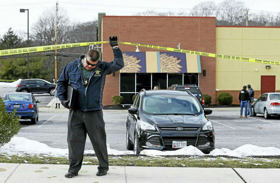 An investigator walks beneath a police tape line at the scene of a shooting at a shopping center in Abingdon, Md., Wednesday, Feb. 10, 2016. A man opened fire inside a shopping center restaurant during lunchtime. Photo: AP Photo/Patrick Semansky / AP