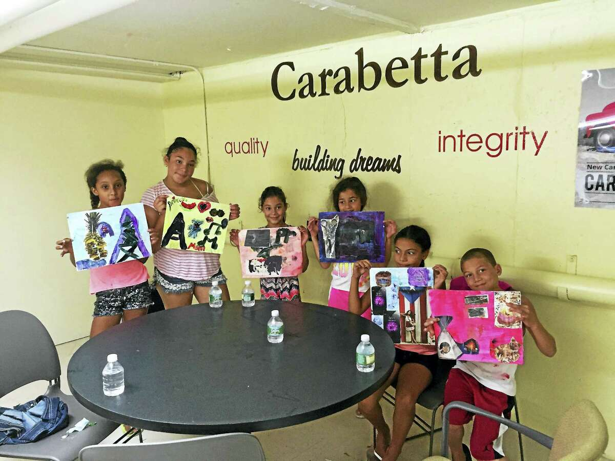 File photo Bielefield students show off their creations. The school is among 15 that have been removed from the focus school list, which designates institutions that revealed an achievement gap in Connecticut Mastery Test scores.