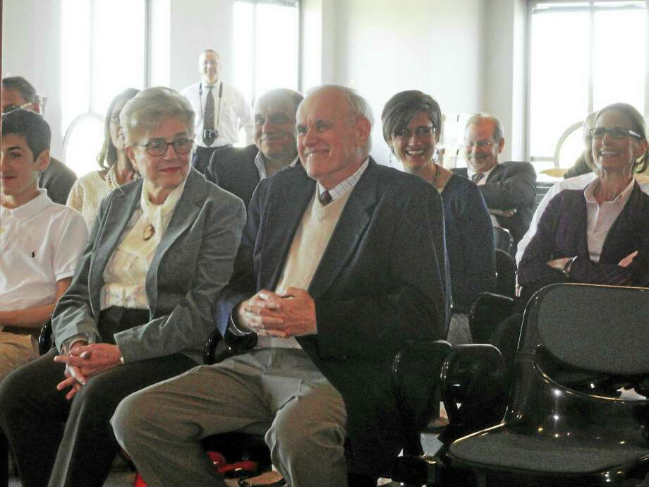 "Dozens of colleagues, law enforcement officials, friends and the family of retired State's Attorney John T. ""Jack"" Redway, right, gathered Friday at Middletown Superior Court for an alternatively humorous and touching tribute. His wife of 56 years, Sue Redway, shares a laugh with her husband. Photo: Cassandra Day — The Middletown Press"