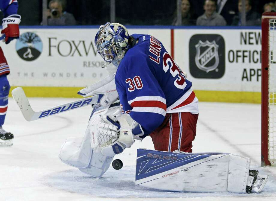 New York Rangers goalie Henrik Lundqvist (30) makes a save against the New Jersey Devils in the third period of an NHL hockey game Monday, Feb. 8, 2016, in New York. The Rangers defeated the Devils 2-1. (AP Photo/Adam Hunger) Photo: AP / FR110666 AP