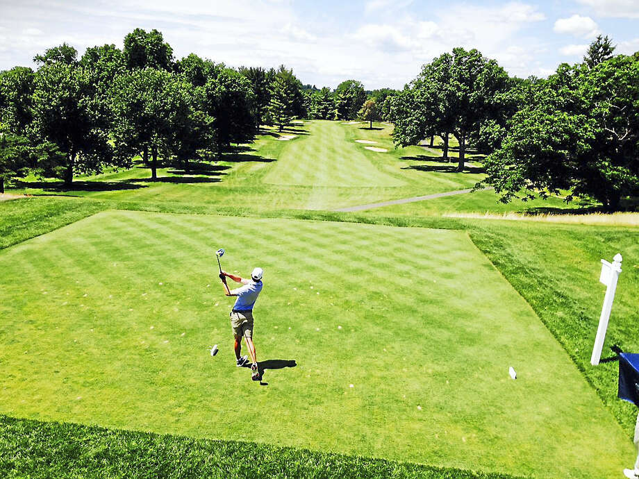 Zach Zaback tees off on the first hole at Wethersfield Country Club on Friday. This shot ended up going into the hole for a double-eagle in the final of the 114th State Amateur golf championship. Photo: Joe Morelli — Register