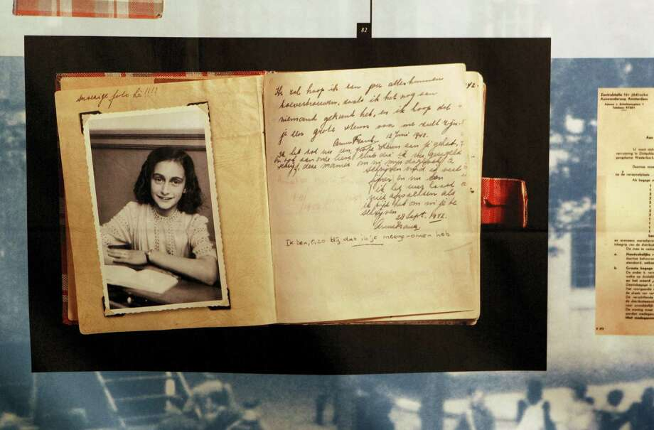 """This June 12, 2009 file photo, shows a photo of Anne Frank at the opening of the exhibition: """"Anne Frank, a History for Today"""", at the Westerbork Remembrance Centre in Hooghalen, northeast Netherlands. A new study by the Anne Frank House museum in Amsterdam said Friday, Dec. 16, 2016, there is no conclusive evidence that the Jewish diarist and her family were betrayed to the Netherlands'Äô German occupiers during World War II, leading to their arrest and deportation. Photo: AP Photo/Bas Czerwinski / AP2009"""