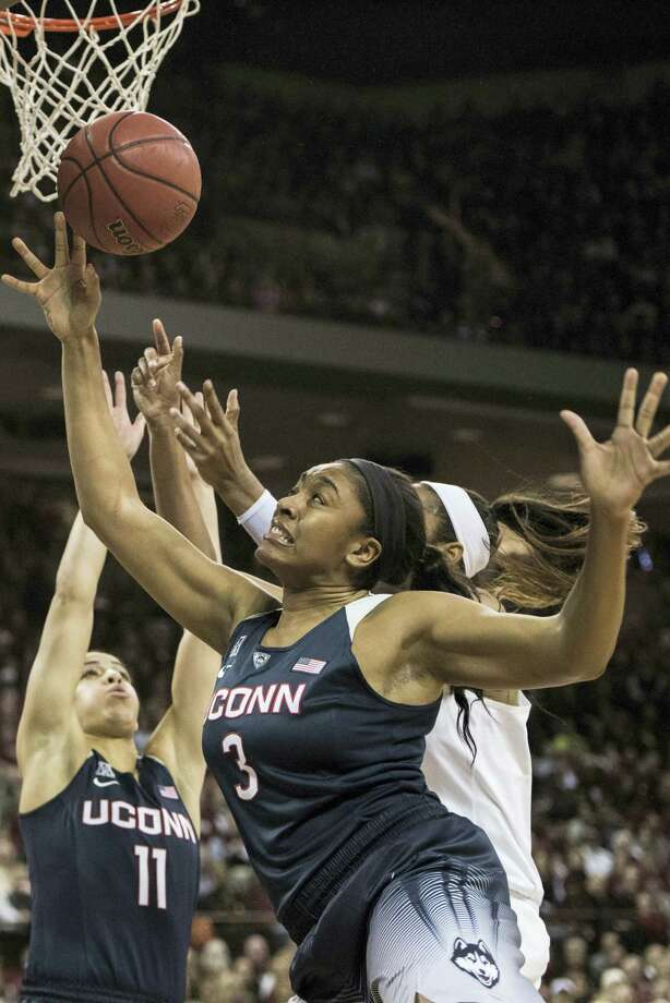 UConn forward Morgan Tuck (3) battles for a rebound against South Carolina on Monday. Photo: Sean Rayford — The Associated Press  / FR171415 AP