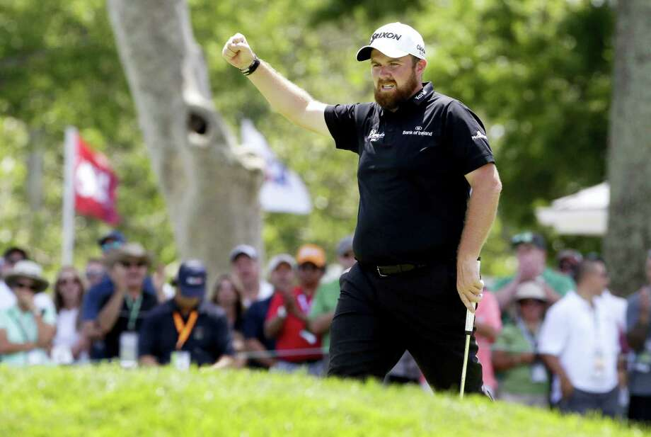 Shane Lowry reacts after making a birdie on the ninth hole on Saturday. Photo: The Associated Press  / AP