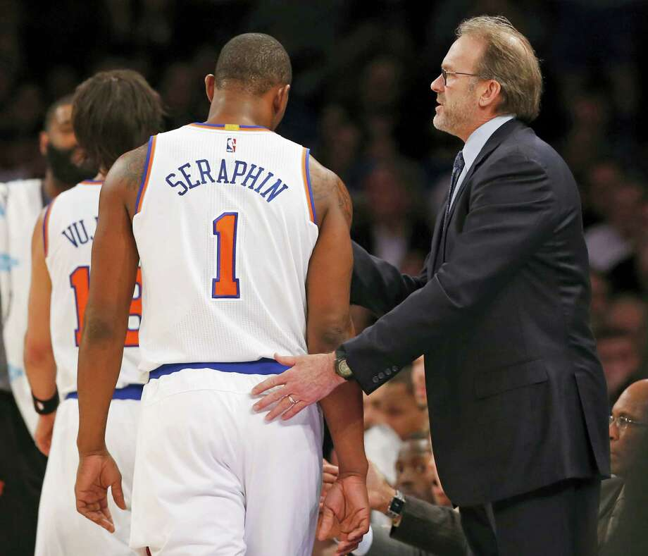 Knicks interim head coach Kurt Rambis pats center Kevin Seraphin on the back during a timeout in the first half on Tuesday. Photo: Kathy Willens — The Associated Press  / AP
