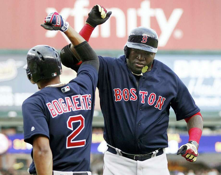 David Ortiz, right, celebrates with Xander Bogaerts (2) after hitting two-run home run in the first inning on Friday. Photo: Duane Burleson — The Associated Press  / FR38952 AP
