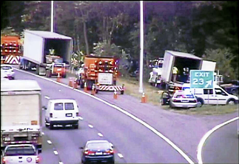 Part of Interstate 91 northbound was shut down for hours Friday after a tractor-trailer went off the highway and crashed into woods near Exit 23. A New Jersey man driving the truck was flown to the hospital for treatment after the accident. Photo: (Photo Courtesy Of The State Department Of Transportation)