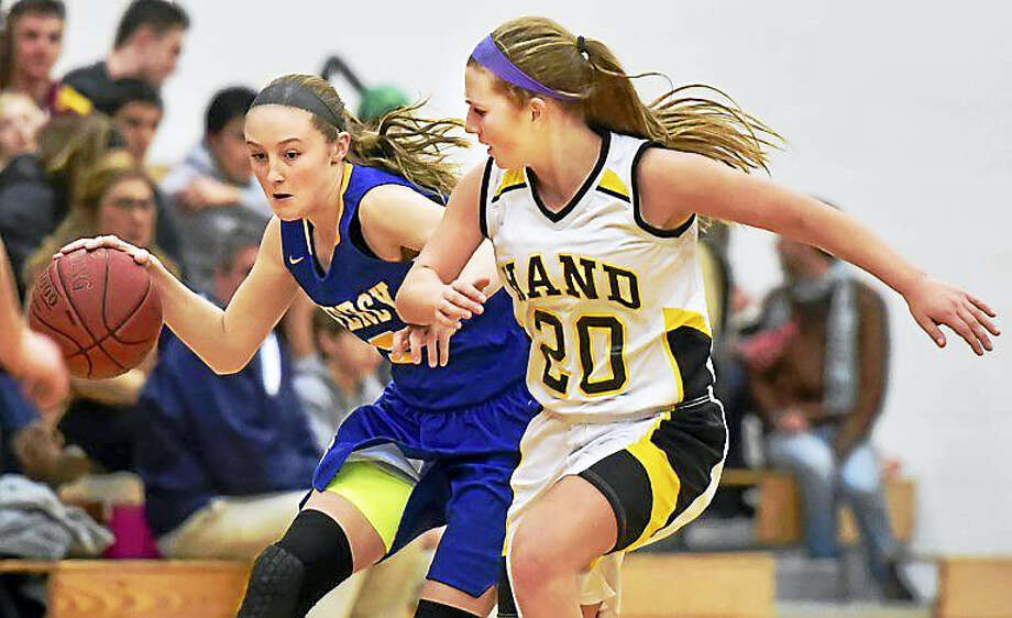 Mercy sophomore Bella Santoro fastbreaks as Hand sophomore Gabriella Egidio defends in a 77-56 win for the Mercy Tigers in late January at Daniel Hand High School in Madison. Photo: Catherine Avalone — The Middletown Press  / New Haven RegisterThe Middletown Press