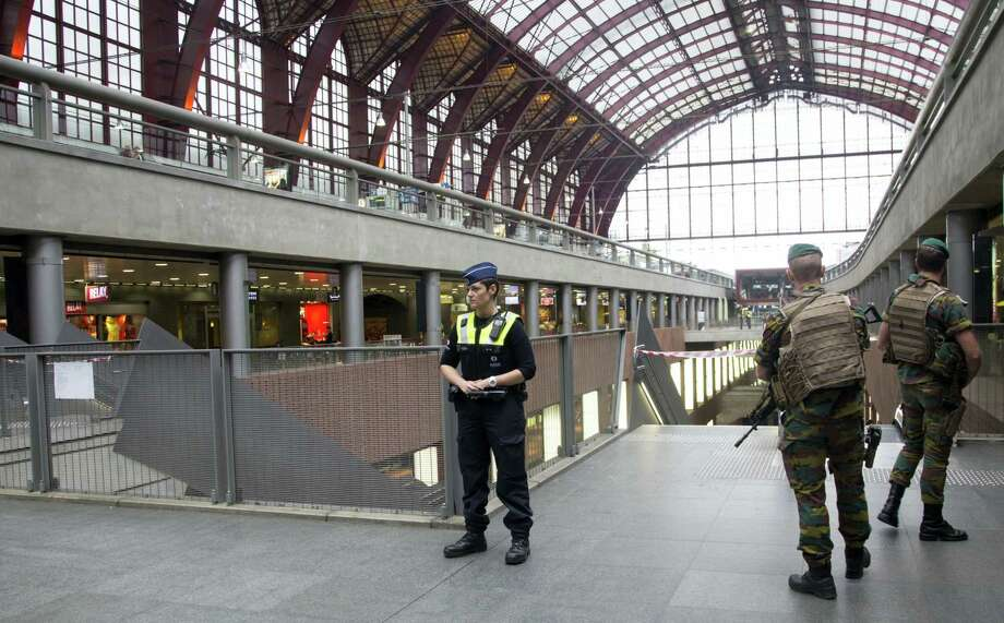 Police and Belgian Army soldiers guard a cordon at Antwerp Central train station in Antwerp, Belgium on Saturday, June 18, 2016. Police and the bomb squad unit responded to a suspect package in the Antwerp station while the Belgian federal prosecutor's office said early Saturday that homes and car ports were searched in 16 municipalities, mostly in and around Brussels in an anti-terror sweep. Photo: AP Photo/Virginia Mayo   / Copyright 2016 The Associated Press. All rights reserved. This material may not be published, broadcast, rewritten or redistribu