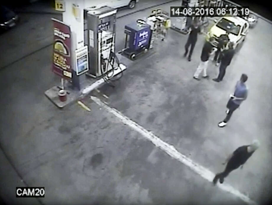 In this Sunday, Aug. 14, 2016, frame from surveillance video released by Brazil police, swimmers from the US Olympic team appear with Ryan Lochte, right, at a gas station during the 2016 Summer Olympics in Rio de Janeiro, Brazil. A top Brazil police official said the swimmers damaged property at the gas station. Photo: Brazil Police Via AP   / AP