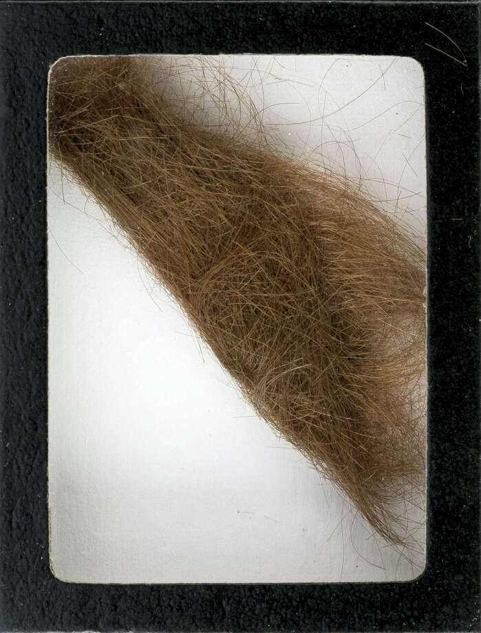"This photo provided by Heritage Auctions shows a 4-inch lock of hair that was collected by a German hairdresser who trimmed John Lennon's hair before he started shooting ""How I Won the War."" Heritage Auctions says the lock of hair is expected to sell for $10,000 at a Dallas auction later this month. Photo: Heritage Auctions Via AP   / Heritage Auctions"