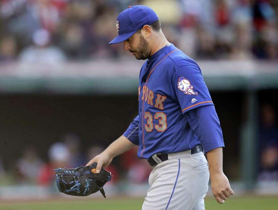 Mets starting pitcher Matt Harvey walks to the dugout in the sixth inning on Saturday. Photo: Tony Dejak — The Associated Press  / AP 2016