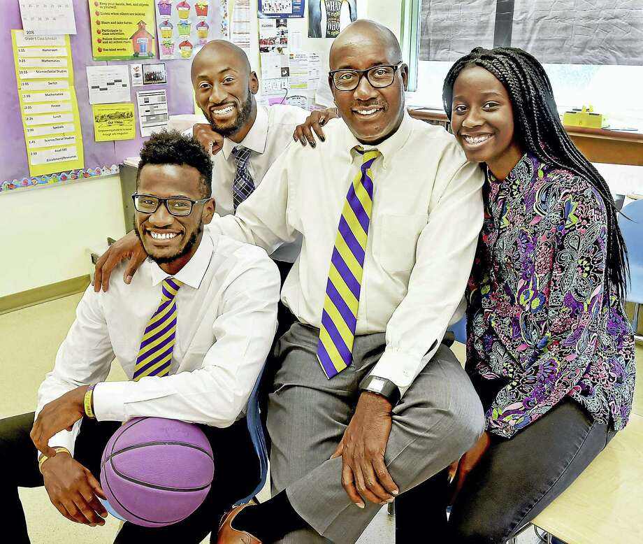 Larry Conaway, 62, the principal at New Light H.S and Riverside Educational Academy in New Haven with his son, Alexander, 23, a Trinsition Fellow and assistant basketball coach at Trinity College, Adham, 26, a teacher at the Davis St. School and Nyka, 15, a rising sophomore at Wilbur Cross, photographed in Adham's classroom, Tuesday, June 14, 2016. Photo: Catherine Avalone — New Haven Register   / New Haven RegisterThe Middletown Press