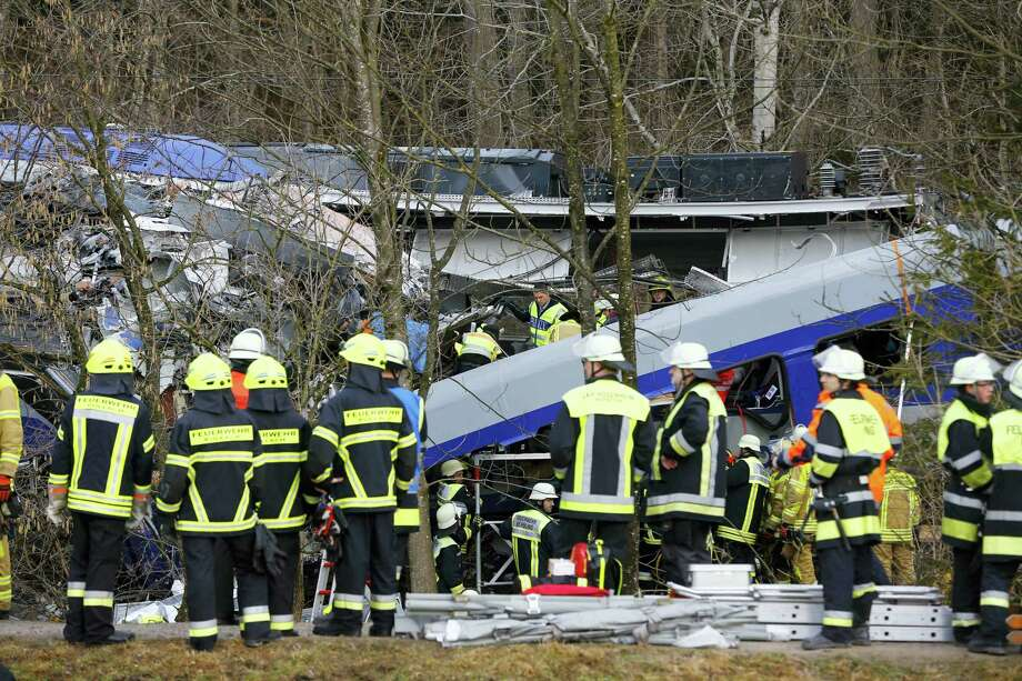 Rescue personnel stand in front of two trains that collided head-on near Bad Aibling, southern Germany, Tuesday, Feb. 9, 2016. Several people have been killed and dozens were injured. Photo: AP Photo/Matthias Schrader   / AP
