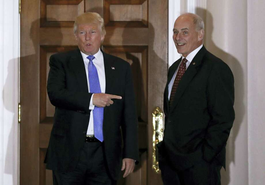 President-elect Donald Trump talks to media as he stands with National Security Adviser-designate, retired Marine Gen. John Kelly at the Trump National Golf Club Bedminster clubhouse in Bedminster, N.J. Photo: Carolyn Kaster — THE ASSOCIATED PRESS  / Copyright 2016 The Associated Press. All rights reserved.