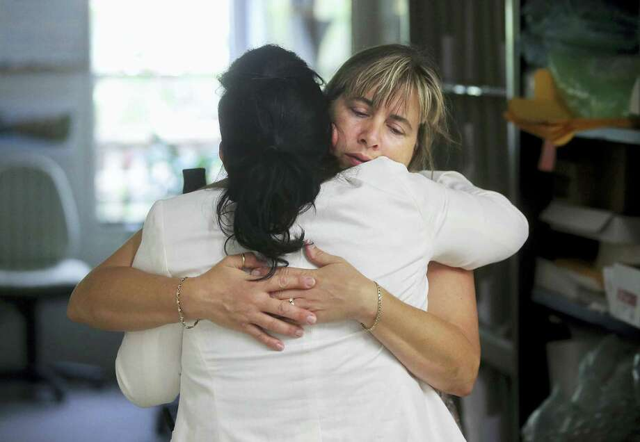 Nina Blakeman, right, of the Palm Beach Zoo receives a hug inside the zoo office after zookeeper Stacey Konwiser, Friday, April 15, 2016 in West Palm Beach, Fla. Stacey Konwiser, 38, was attacked and killed by a 13-year-old male tiger in an enclosure known as the night house that is not visible to the public, Palm Beach Zoo spokeswoman Naki Carter said. It's where the tigers sleep and are fed. Photo: Damon Higgins/Palm Beach Post Via AP   / Palm Beach Post