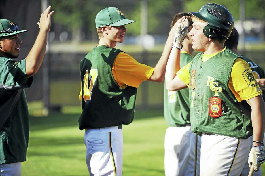 Jimmy Zanor - The Middletown PressRCP shortstop Cory Baldwin, right, gets a round of high-fives after scoring a first inning run against West Hartford on Friday night at Monnes Field. Photo: Journal Register Co.