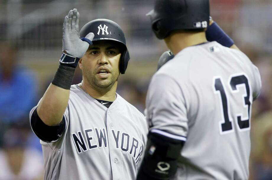 The Yankees' Carlos Beltran, left, gets a high five from Alex Rodriguez following his two-run home run off Twins pitcher Pat Dean in the first inning Friday in Minneapolis. Photo: Jim Mone — The Associated Press  / Copyright 2016 The Associated Press. All rights reserved. This material may not be published, broadcast, rewritten or redistribu