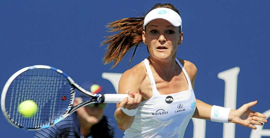 Poland's Agnieszka Radwanska returns to the Connecticut Open this year after accepting a wild card into the main draw. Photo: Bob Child — Register FILE PHOTO