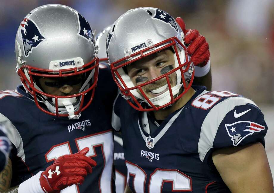 New England Patriots tight end A.J. Derby, right, celebrates his touchdown catch with wide receiver Aaron Dobson (17) during the second half on Thursday. Photo: Charles Krupa — The Associated Press  / Copyright 2016 The Associated Press. All rights reserved. This material may not be published, broadcast, rewritten or redistribu