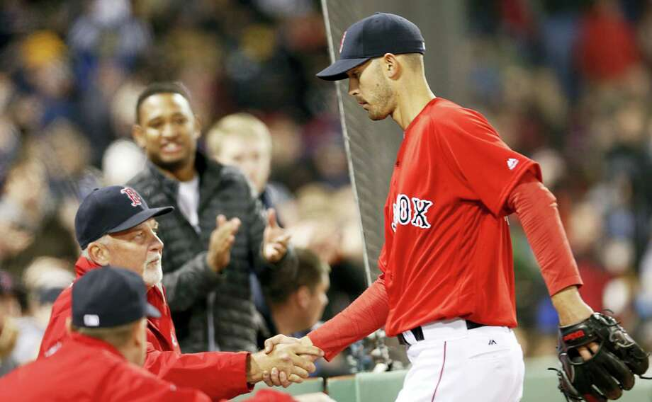 Rick Porcello is congratulated at the dugout as he leaves the game during the seventh inning on Friday. Photo: Mary Schwalm — The Associated Press  / FR158029 AP