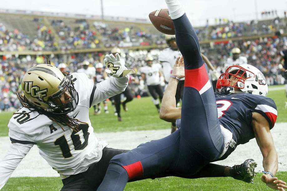 Central Florida defensive back Shaquill Griffin, left, breaks up a pass in the end zone intended for UConn's Brian Lemelle on Saturday. Photo: Stew Milne — The Associated Press  / FR56276 AP