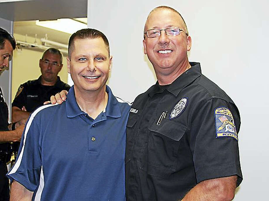 Officer First Class Gary Jarzabek, left, retired from the force this week. Photo: Courtesy Kevin Armstrong