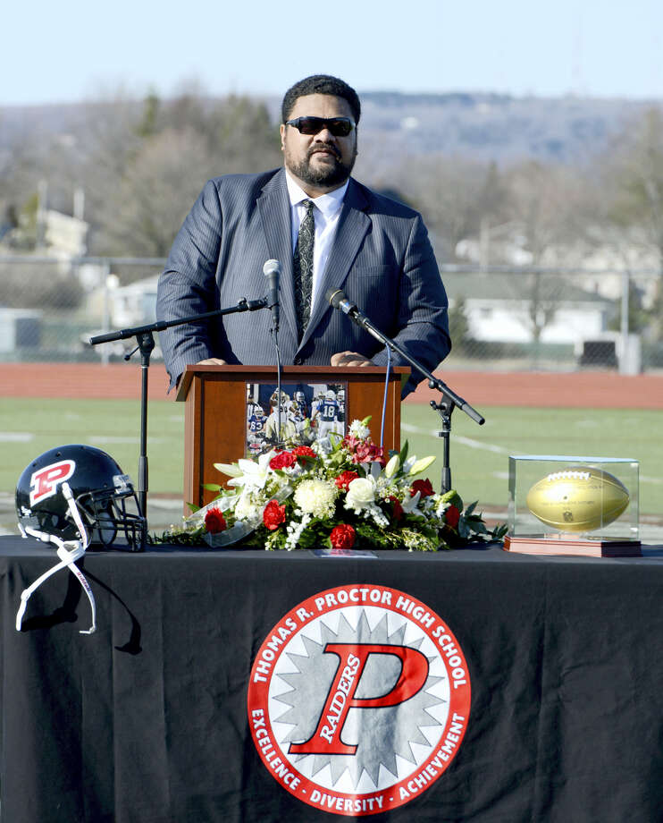 Penny Semaia, a friend and former high school football teammate of Will Smith, speaks during a ceremony to honor the life and legacy of former New Orleans Saints defensive end Will Smith at the school in Utica, N.Y., Thursday, April 14, 2016. Semaia was a high school football teammate of Smith, who was shot and killed last Saturday. Smith lived in Utica as a child with his grandmother, Nancy Smith, and played football for the high school. Photo: Tina Russell/Observer-Dispatch Via AP  / Observer-Dispatch