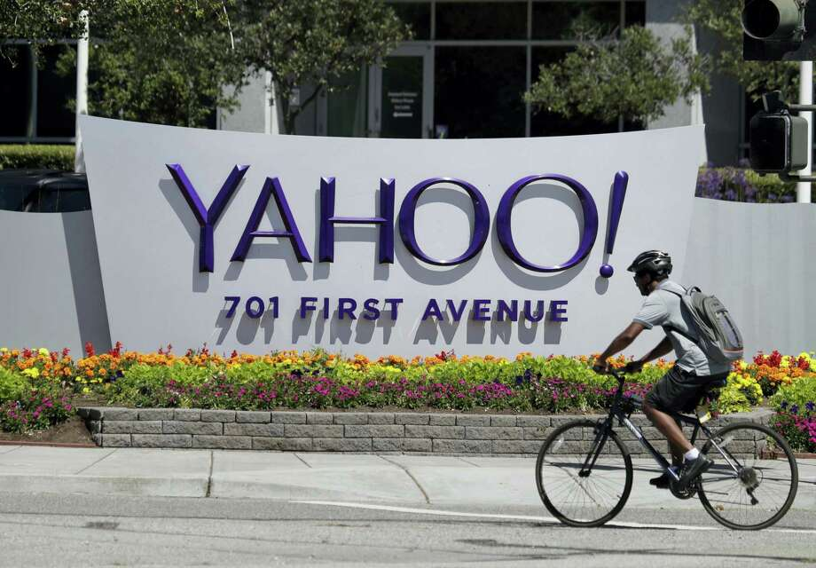 A cyclist rides past a Yahoo sign at the company's headquarters in Sunnyvale, Calif. The Yahoo hack announced Wednesday, Dec. 14, 2016 exposed personal details from more than 1 billion user accounts, potentially the largest breach of an email provider in history. Photo: Marcio Jose Sanchez — AP Photo  / Copyright 2016 The Associated Press. All rights reserved.