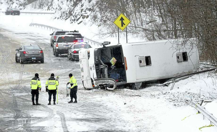 State police investigate an overturned bus on northbound Interstate 95 in Madison Monday. Photo: Arnold Gold — New Haven Register