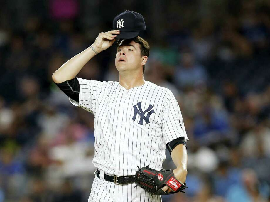 New York Yankees relief pitcher Anthony Swarzak reacts in the sixth inning against the Toronto Blue Jays in New York, Tuesday. The Blue Jays rallied for a 12-6 victory. Photo: Kathy Willens — The Associated Press  / AP