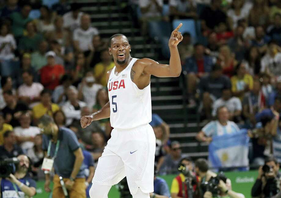 United States' Kevin Durant (5) signals to teammates after he scored against Argentina during a men's quarterfinal round basketball game at the 2016 Summer Olympics in Rio de Janeiro, Brazil, Wednesday, Aug. 17, 2016. (AP Photo/Eric Gay) Photo: AP / Copyright 2016 The Associated Press. All rights reserved. This material may not be published, broadcast, rewritten or redistribu