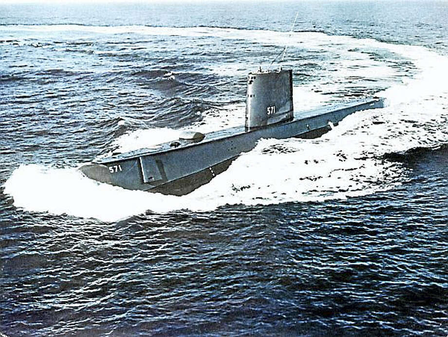 USS NAUTILUS (SSN 571) making a tight full-speed turn while on sea trials. Photo: Photo Courtesy Of The U.S. Navy