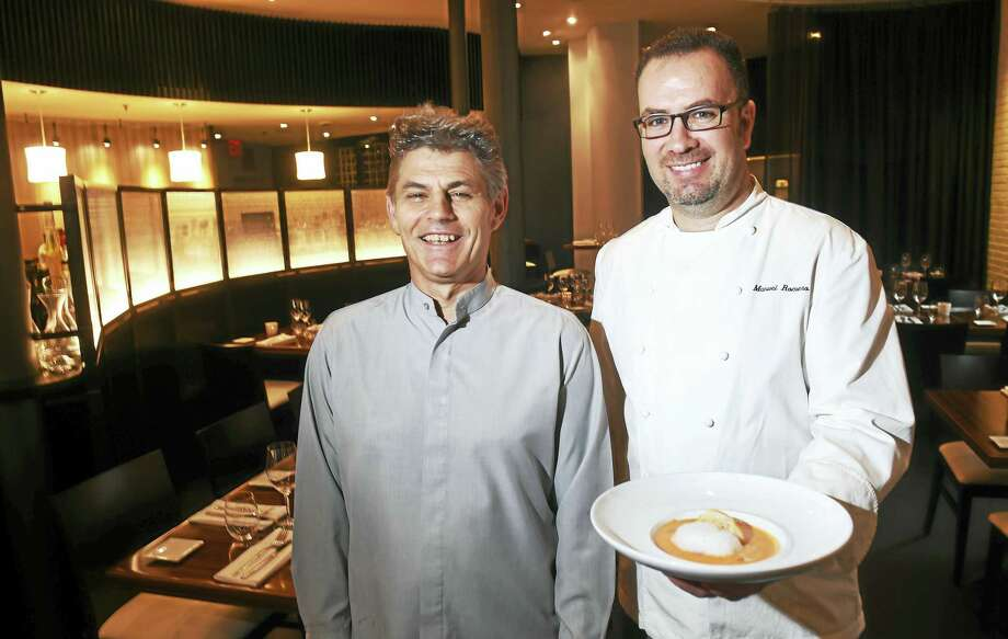 Olea manager Juan Gonzalez, left, is photographed with executive chef and co-owner Manuel Romero holding a bowl of gazpacho at their restaurant on High Street in New Haven. Photo: Arnold Gold — Register