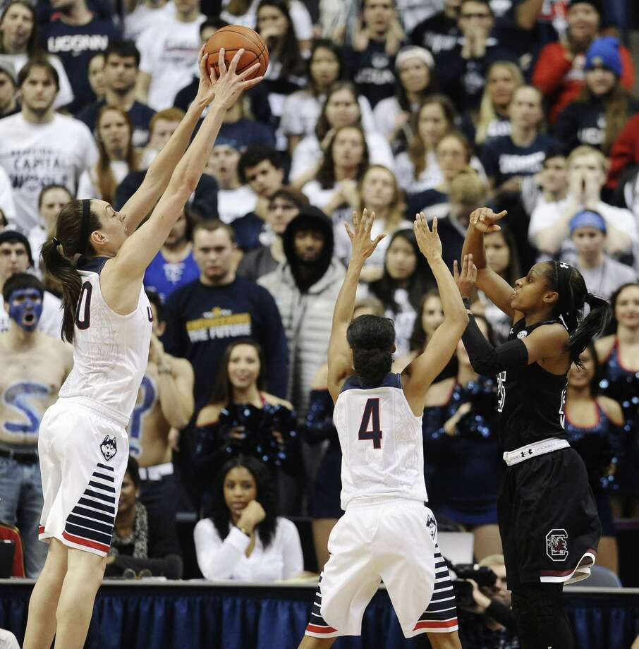 Connecticutís Breanna Stewart, left, blocks a shot attempt by South Carolinaís Tiffany Mitchell, right, as Connecticutís Moriah Jefferson, center, defends during the second half of an NCAA college basketball game, Monday, Feb. 9, 2015, in Storrs, Conn.  UConn won 87-62. (AP Photo/Jessica Hill) Photo: AP / AP2015