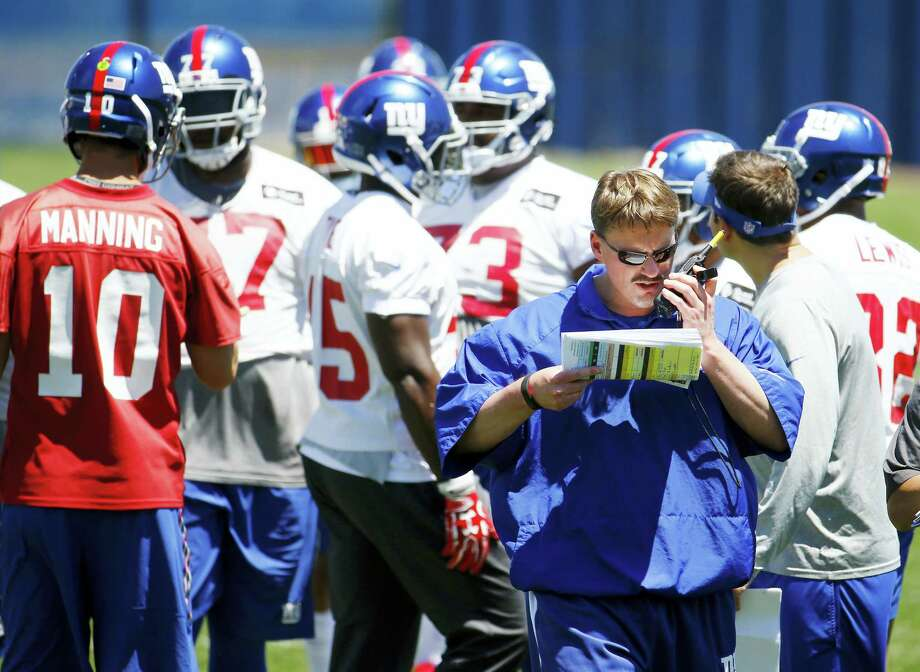 Giants head coach Ben McAdoo talks talks on a radio during a recent practice. Photo: Julio Cortez — The Associated Press  / Copyright 2016 The Associated Press. All rights reserved. This material may not be published, broadcast, rewritten or redistribu