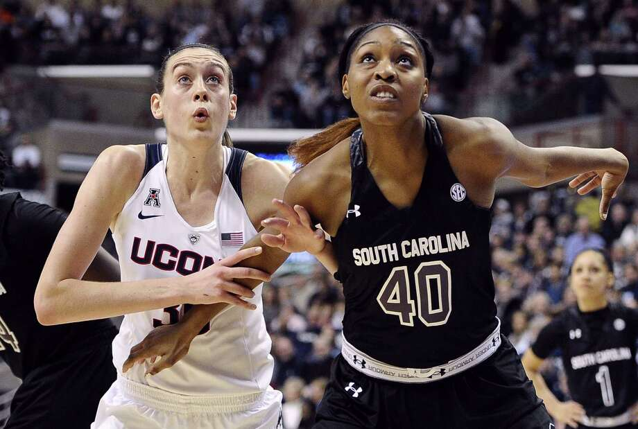 Connecticutís Breanna Stewart, left, and South Carolinaís Jatarie White, right, look for a rebound during the first half of an NCAA college basketball game, Monday, Feb. 9, 2015, in Storrs, Conn. (AP Photo/Jessica Hill) Photo: AP / FR125654 AP