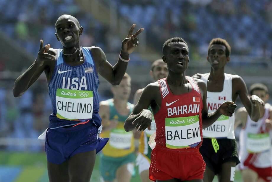 United States' Paul Kipkemoi Chelimo, left, wins a men's 5000-meter heat ahead of fourth placed Bahrain's Birhanu Balew during the athletics competitions of the 2016 Summer Olympics at the Olympic stadium in Rio de Janeiro, Brazil, Wednesday, Aug. 17, 2016. Photo: AP Photo/David J. Phillip   / Copyright 2016 The Associated Press. All rights reserved. This material may not be published, broadcast, rewritten or redistribu