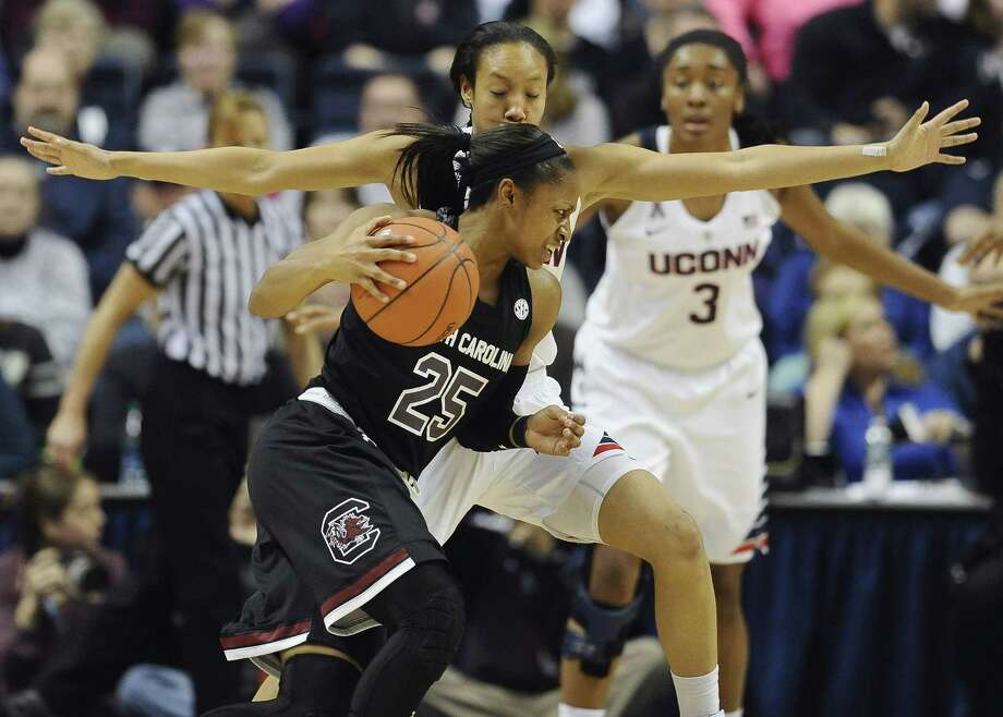 South Carolinaís Tiffany Mitchell, front drives around Connecticutís Saniya Chong, back, during the first half of an NCAA college basketball game, Monday, Feb. 9, 2015, in Storrs, Conn.  UConn won 87-62. (AP Photo/Jessica Hill) Photo: AP / AP2015