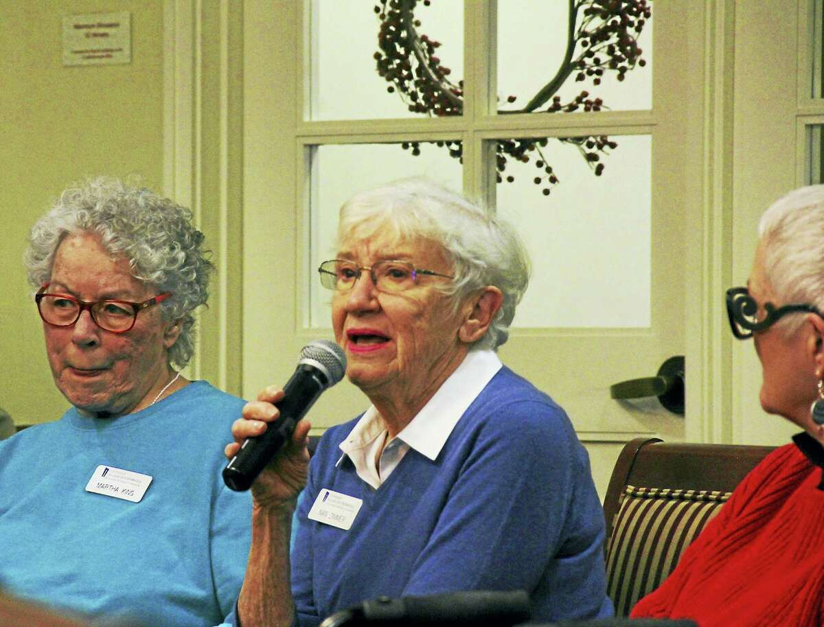 From left, seniors Martha King, Nan Zimmer and Ann Grasso respond to remarks offered by Middlesex Community College students Thursday.