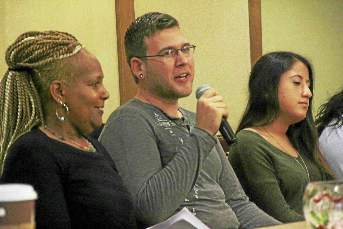 From left, Middlesex Community College students Valerie Williams-Smith, Jon Nash and Carina Malik. The students enrolled in the Middletown school participated in a panel Thursday at Covenant Village in Cromwell.