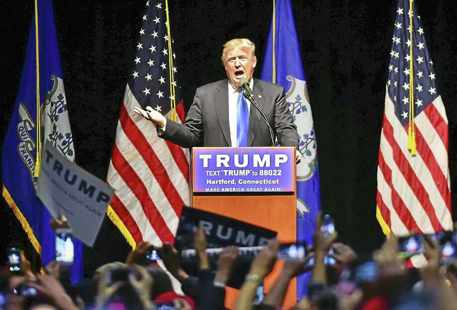 Donald Trump, frontrunner in the race for the Republican presidential nomination, speaks to supporters Friday at the Connecticut Convention Center in Hartford. Photo: Catherine Avalone — New Haven Register  / New Haven RegisterThe Middletown Press