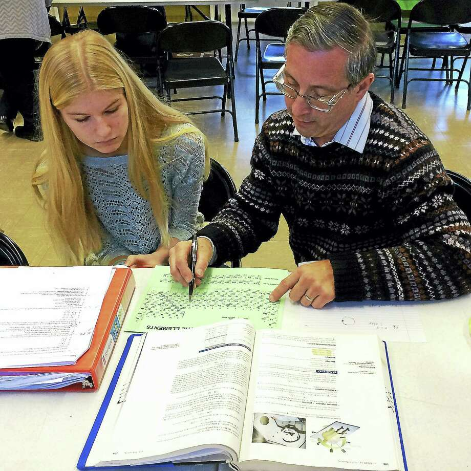 Student Jessica Hart gets help from volunteer Richard Hank at the after-school homework help center at Grace Evangelical Lutheran Church in Middletown. Children in kindergarten through 12th-graders who live in surrounding towns may also take part in the program. Photo: Courtesy Photo
